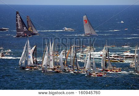 Sydney Australia - December 26 2013. While Wild Oats already on open water last yachts just turning to Tasman Sea. Sydney to Hobart Yacht Race on Boxing day.