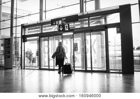An Airline Passenger Exiting an Airport Exit