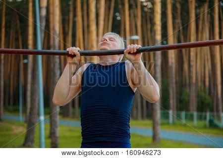 Closeup Of Strong Man Doing Pull-up On Horizontal Bar.