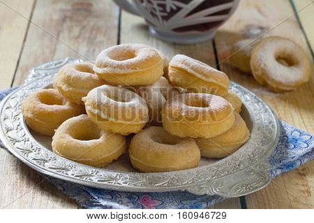 Donuts With Powdered Sugar On A Wooden Background. Hanukkah Celebration Concept. Copy Space.