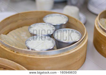 Making traditional korean rice flour steamed cake tteok horizontal