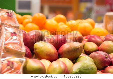 Close up view of of fresh fruits on the shelf in the supermarket