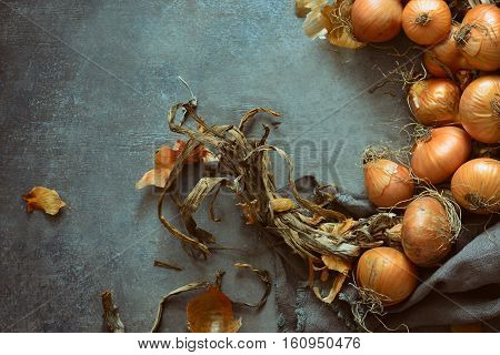 Rustic food ingredients raw vegetables such as onions laying on a vintage table surface organic cooking concept