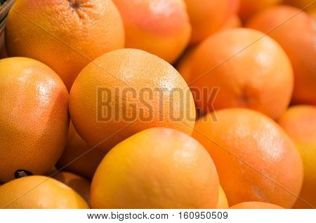 Background from a fresh fruits on the shelf in the supermarket