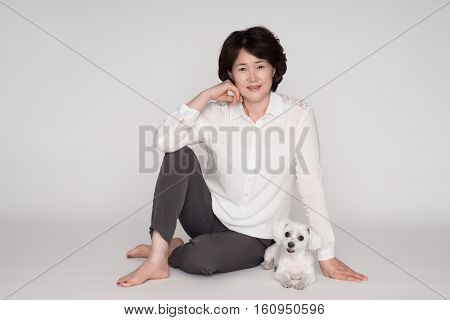 Studio Portrait shoot of Asian middle-aged woman in 50s - Isolated