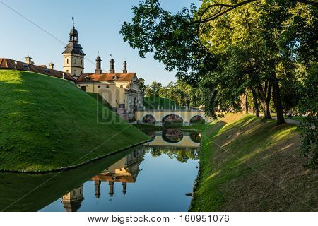 NESVIZH, BELARUS - AUGUST 20.2016:  Castle in the Belarusian town of Nesvizh with reflection in water