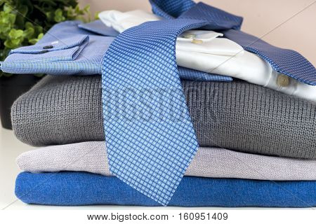 set of men's clothing on wooden background. Men's casual clothes and accessories on wooden background.