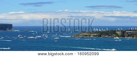 Sydney Australia - December 26 2013. Last participant yachts leaving Sydney Harbour. The Sydney to Hobart Yacht Race is an annual event starting in Sydney on Boxing Day and finishing in Hobart.