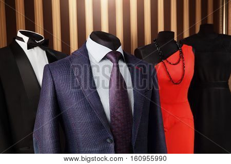 Half mannequin Men and Lady in elegant suit with dress