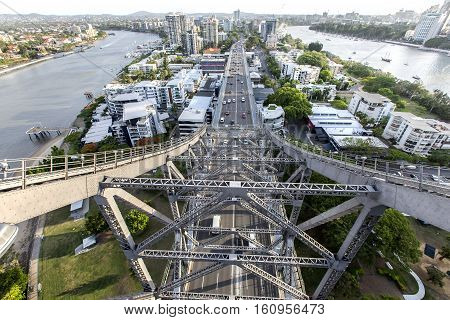 BRISBANE, AUSTRALIA - December 5 2016: raffic passing under the southern side of Brisbane Story Bridge with view of Kangaroo Point and Captain Burke Park