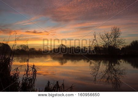 The sun rises over the river thames in Oxfordshire United Kingdom