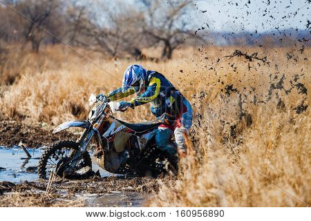KHABAROVSK RUSSIA - OCTOBER 23 2016: Enduro bike rider stuck in the mud