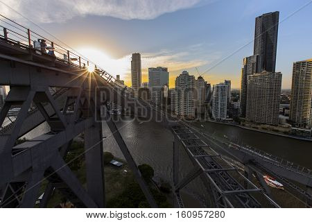 BRISBANE, AUSTRALIA - December 5 2016: Brisbane Story Bridge summit viewing platform and stairway silhouette as the sun sets over Brisbane City.