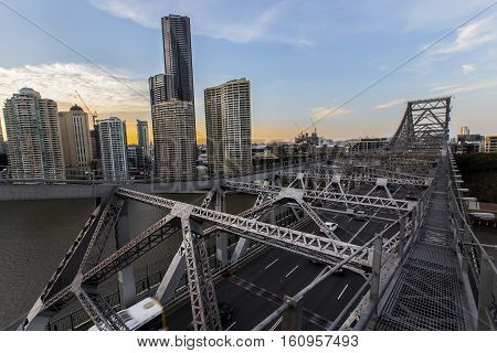 BRISBANE, AUSTRALIA - December 5 2016: Looking across Brisbane Story Bridge span on the walkway above the bridge as the sunsets over Brisbane City.