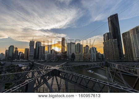 BRISBANE, AUSTRALIA - December 5 2016: Brisbane Story Bridge architecture looking over the Story Bridge towards a colourful sunset over Brisbane City