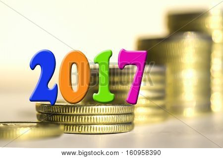 2017 amid bars coins . The concept of the new fiscal year .