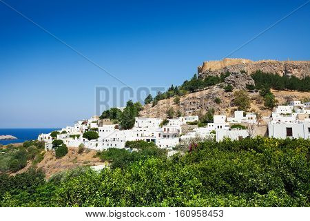 Beautiful view of Lindos town at the foot of the mountain and ancient Acropolis, Greece