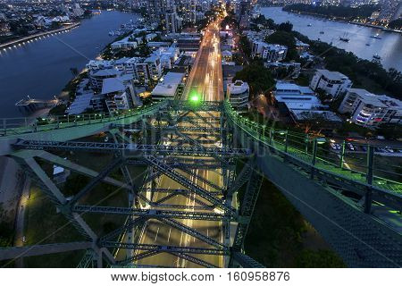 Night traffic trails passing under the southern side of Brisbane Story Bridge,close up