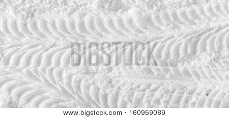 Car tire tracks, tire tracks on the snow, snow background, winter pattern, grunge