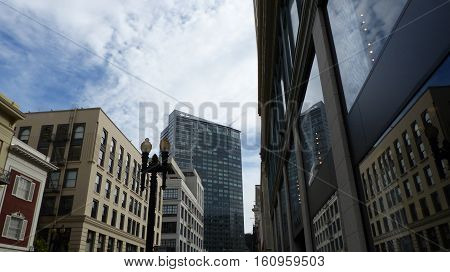 Street in the downtown of San Francisco, different architecture, blue sky and white clouds