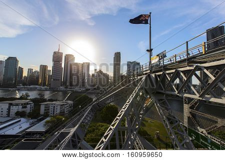 Australian flag flying above the Brisbane Story Bridge during sunset