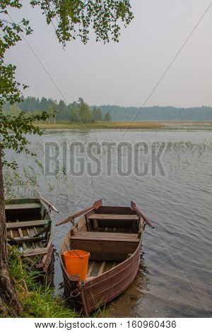 Wooden boat on the lake. Karelia, Russia