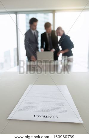Focus on document on a desk, legal persons, parties to contract, have negotiated an important agreement and ready to sign a contract, valid and enforceable document, have forgotten about it. Close up