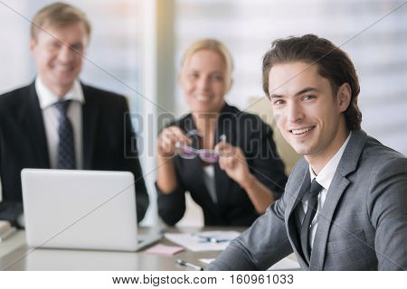 Group of business people, partners together to establish and grow a business, portrait of young man with perfect portfolio, study as investment, family business, generation of business owners