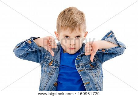 Portrait of a dissatisfied boy, showing a thumbs down, isolated on white background