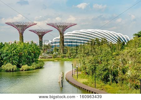SINGAPORE - OCTOBER 09 2016: Singapore Supertrees Flower Dome and Cloud Forest buildings in Gardens by the Bay at Bay South Singapore.