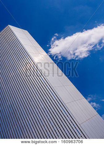 Contemporary architecture and regeneration at Salford Quays near Manchester England set against a deep blue sky and well placed white cloud