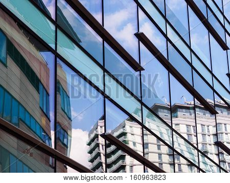 Reflections in buildings demonstrating contemporary architecture and regeneration at Salford Quaysnear Manchester England.