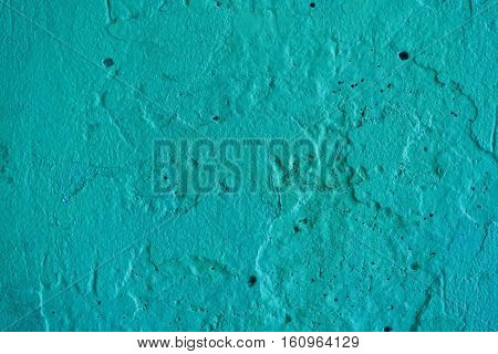 Stucco turquoise wall background or texture.Plaster, plaster texture, plaster background. Turquoise wall, turquoise background. Concrete, concrete background.