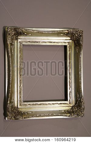 Vintage blank frame for paintings on the wall