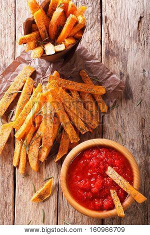 Fried Sweet Potato Wedges With Herbs And Ketchup Close-up. Vertical Top View