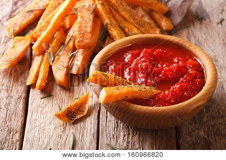 Fried Sweet Potato Wedges With Herbs And Ketchup Close-up. Horizontal