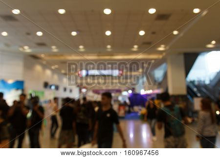 Abstract blurred people in trade show expo. background