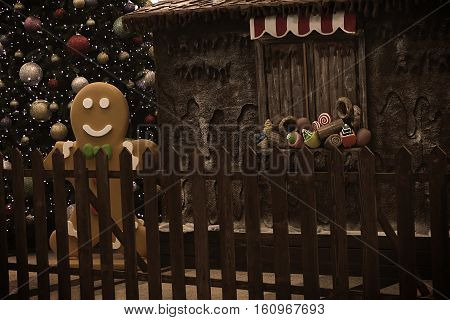 A Christmas tree with glittery baubles near various fake cupcakes, candy, doughnuts, and ice cream cones decoration on wooden window ledge.