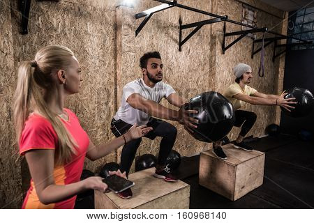 Sport Fitness People Group Crossfit Training Equipment, Young Healthy Man And Woman Gym Interior Doing Exercises