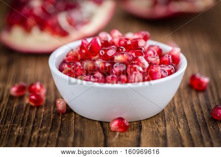 Pomegranate Seeds On Wooden Background (selective Focus)