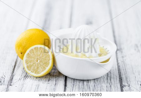 Wooden Table With Lemon Juice (selective Focus)