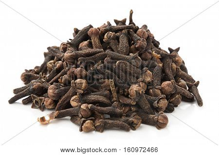 Heap of dried cloves, syzygium aromaticum, isolated on white background.