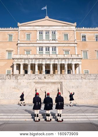 Athens Greece - March 28 2016: Crowd admiring and photographing the changing of the honor Presidential guards ceremony in front of the Tomb of the Unknown Soldier in Syntagma Square Athens Greece.