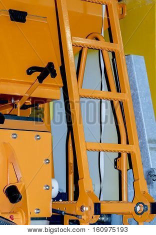 Retractable ladder on cargo specialist car yellow