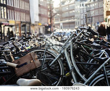 many bicycles on street of Amsterdam city, parking ideal traffic eco healthy lifestyle concept close up at sunlight, health care stuff blured