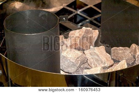 Stones in the furnace of bath on a metal grate