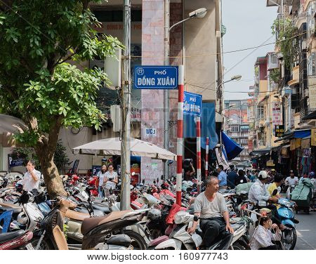Vietnam, Hue - October 21, 2016: Vietnam, Hue Population and scooter traffic in the downtown of Hue