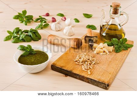 Fresh pesto genovese sauce over a wooden background