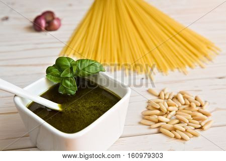 Closeup of pesto genovese and linguine pasta pine nuts and garlic on a table