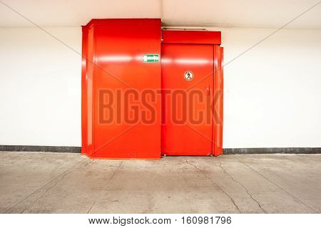 in a tunnel there are red doors with prohibitory to get there